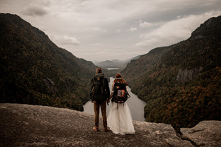 Bride and groom in wedding attire on Indian Head in the ADKs