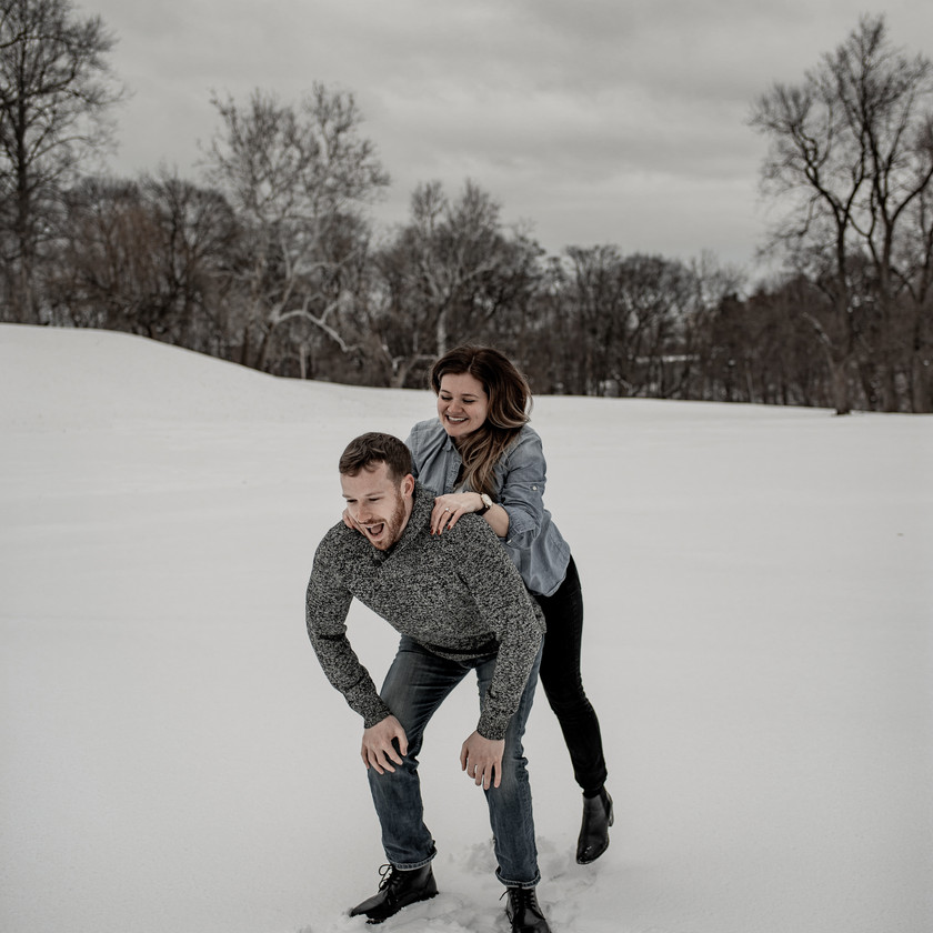 Fun and creative winter engagement photo in Troy NY