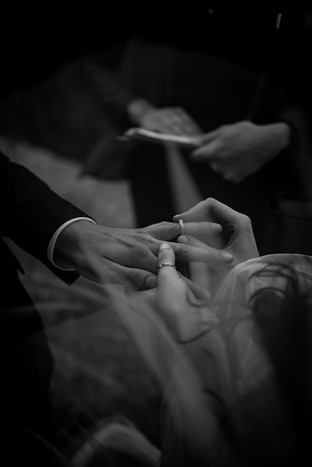 Photo of Mary putting wedding Ring on Isaac during Adirondack elopement