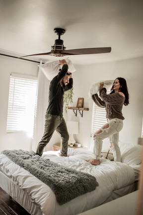 Couples photography pillow fight