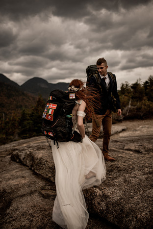 Hiking a mountain in a wedding dress for an Adirondack elopement