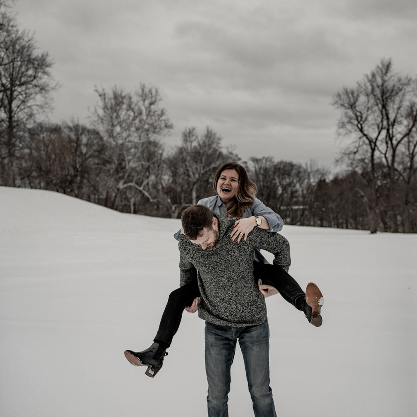 Piggy back ride engagement photo in Troy NY