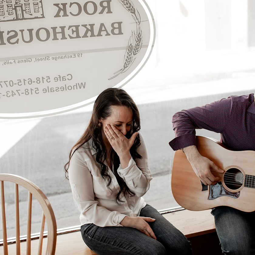 Crying engagement photo with a guitar in Glens Falls NY