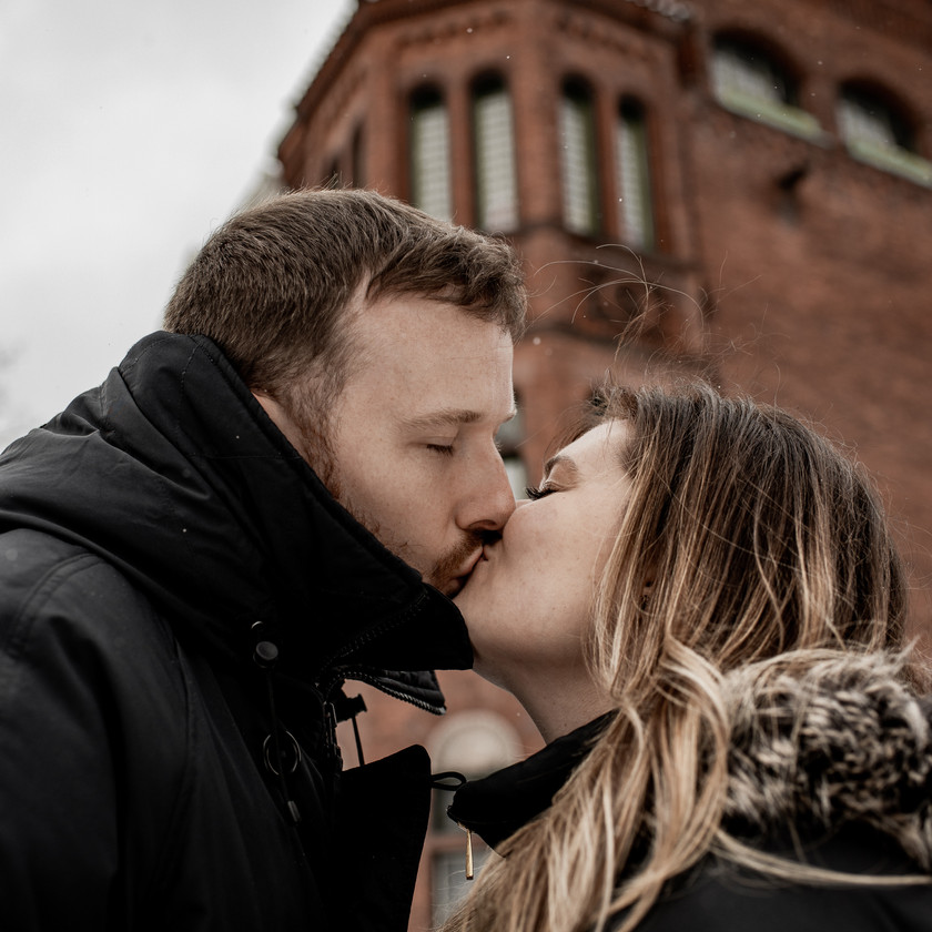 Kissing in downtown Troy for engagement photos