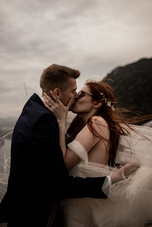 Mary and Isaac's first kiss at their sunrise Adirondack elopement