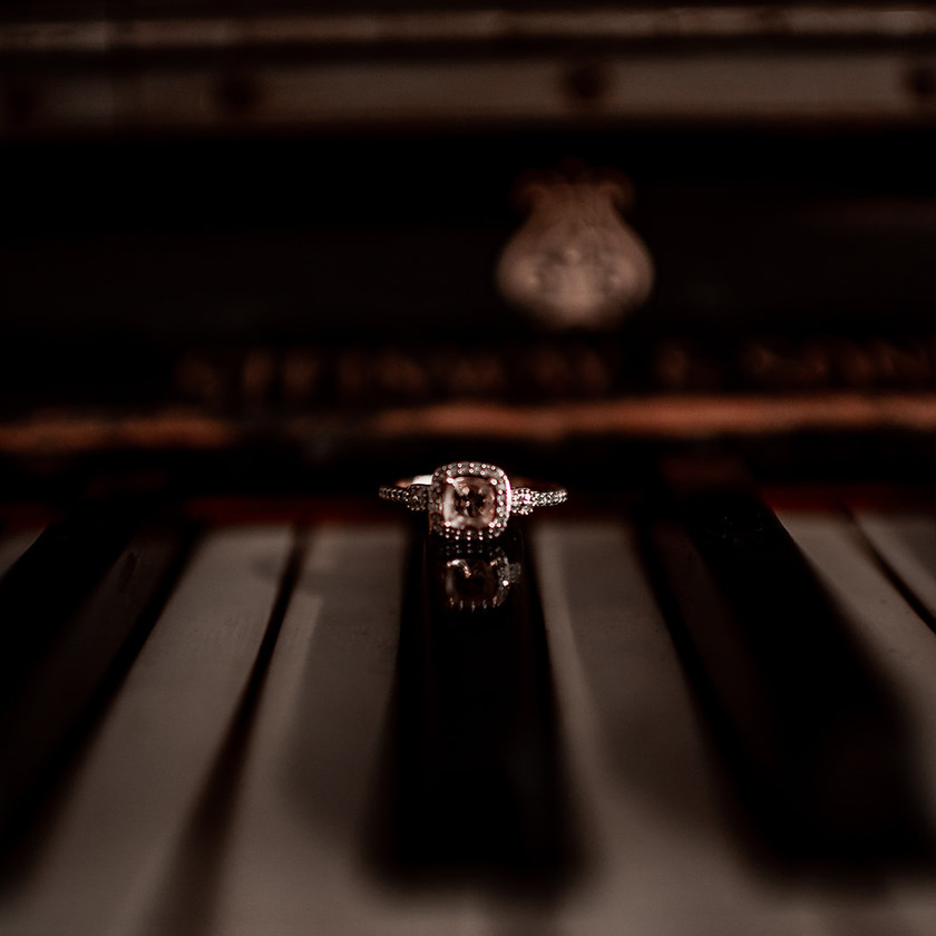 Detail shot of engagement ring on a piano in Glens Falls NY