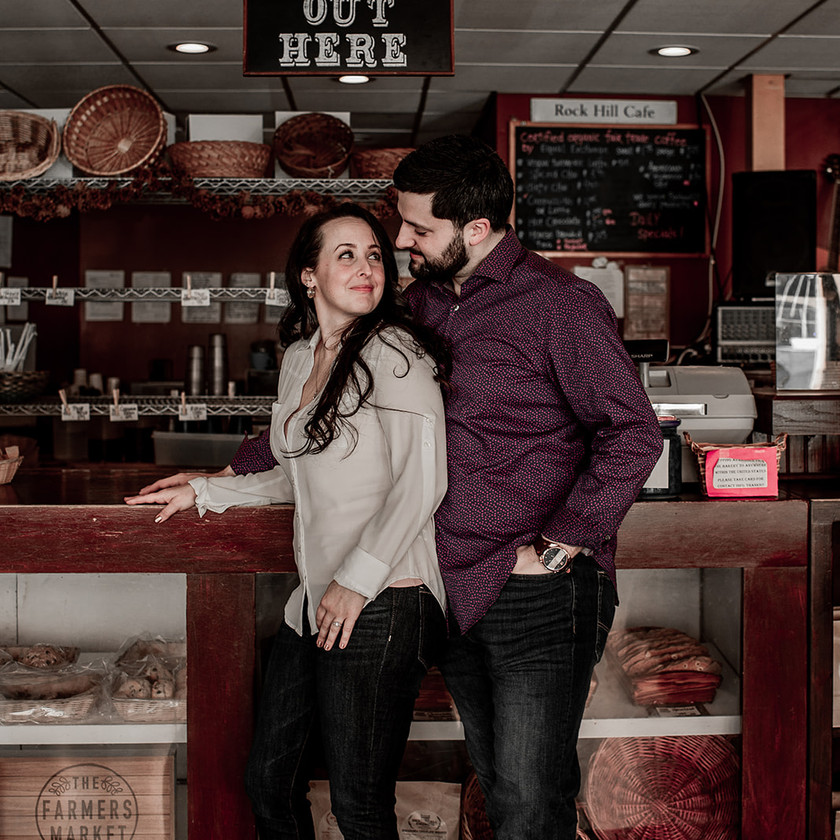 Cute couples photography pose in a cafe in Glens Falls