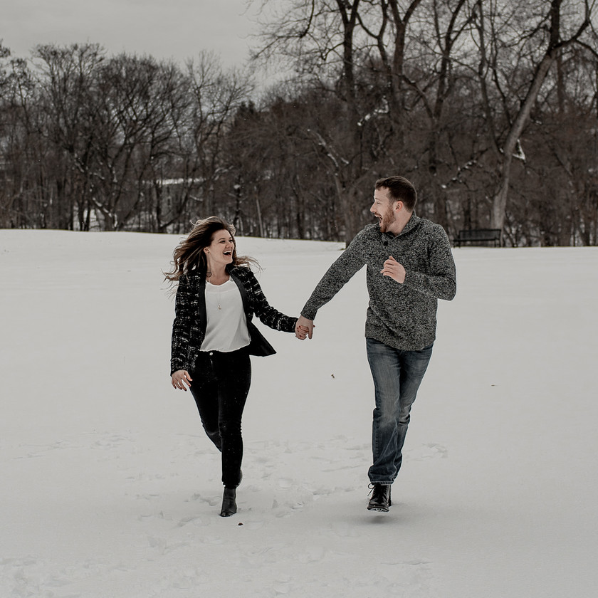 Fun couples photography pose in the snow in Troy NY