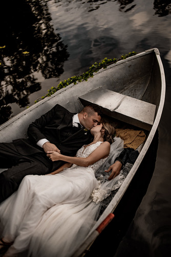 Wedding portraits in a boat on lake in Adirondacks