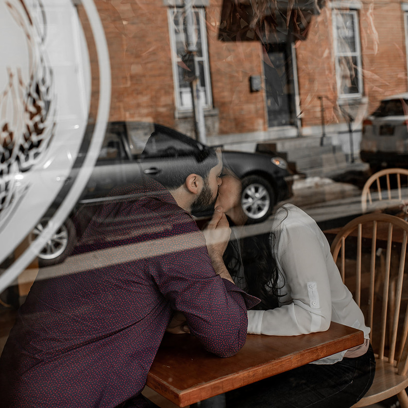 Kissing through a window in Glens Falls NY