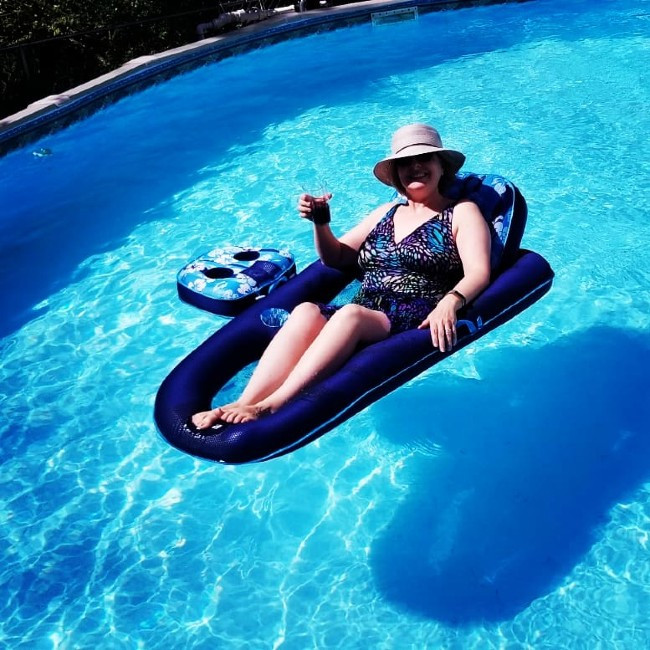 Micki Bare floating in pool on Mother's Day