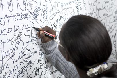 Commonwealth 8.7 Network, Woman using whiteboard