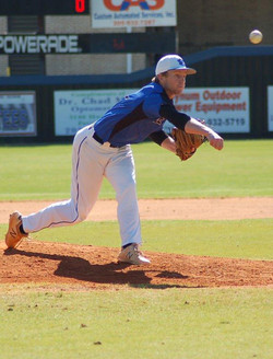 Baseball Player Pitching