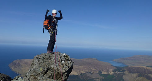 Women celebrating on sumit of the Inaccessible Pinnacle, Scotland Spring