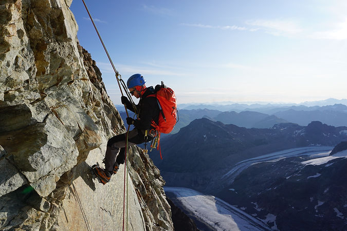 Climber abseiling in the Alps
