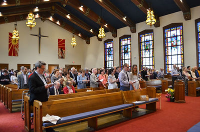 Refomaion members in worship in the sanctuary on Sunday Morning