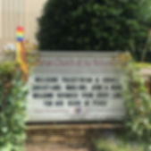 "Our front sign with our name ""Lutheran Church of the Refomation ELCA"" and a sign message that reads, ""Welcome Palestinian & Israeli Christiansm, Muslims, Jews, & More! Welcome Refugees from Every Land. You are seeds of peace."" There are rainbow pride banners adorning the sign."