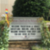 """Our front sign with our name """"Lutheran Church of the Refomation ELCA"""" and a sign message that reads, """"Welcome Palestinian & Israeli Christiansm, Muslims, Jews, & More! Welcome Refugees from Every Land. You are seeds of peace."""" There are rainbow pride banners adorning the sign."""