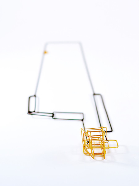 Title: Scafolding gold Necklace 1  Materials: Gold plated silver nickel and fused iron, transparent lacquer  used and constructed iron and constructed silver nickel gold plated.  Measurements: 52 x 9 x 3.5  Technique: fused and constructed iron and constructed silver nickel gold plated Date of work: 2016