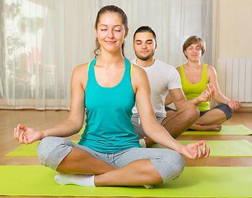 happy group having yoga class in sport c