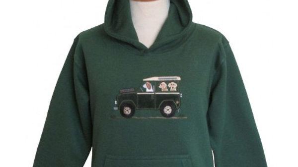 Dogs in a Defender hoodie
