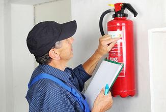 A Professional checking aFire extinguish