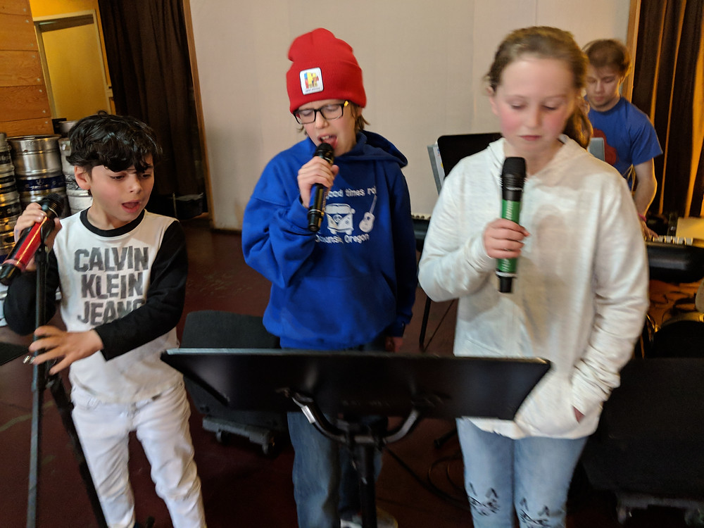 These older kiddos are taking full advantage of Emerson on piano and the mics to have their own personal rock show. So much fun!