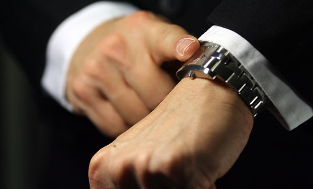 Man-Tapping-His-Wristwatch.jpg