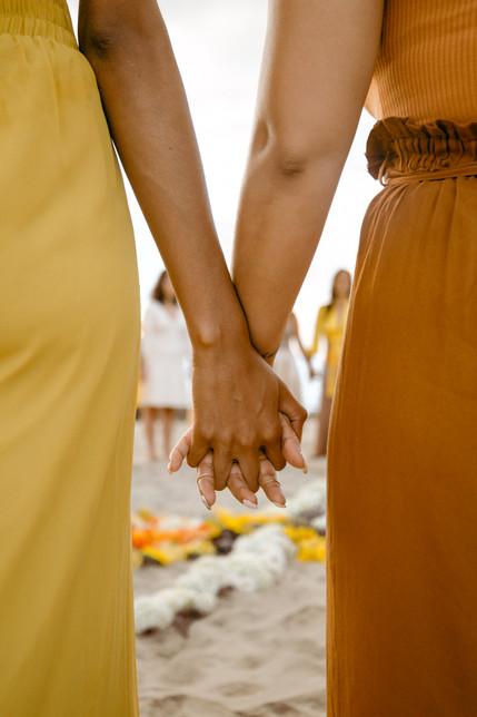 Cyn Lagos Holding hands close up.jpg