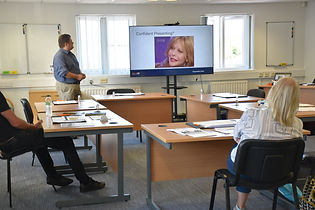 Andy Evans in Learning and Development presenting in our meeting room