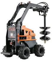 John telfer mini diggers mini loader carries out post hole digging and rotary hoe works for landscaping preparation.