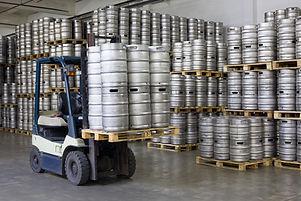 Forklift loading beer kegs in warehouse brewery .jpg