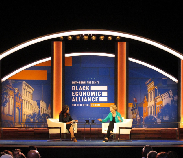 Black Economic Alliance Charleston Music Hall, Charleston, SC Scenic: Upstage portal; carpet template; shoot off walls; backdrop; masking walls Production: Brick columns; portal header Production Design: Tom Lenz for 513 Associate Production Designer: Mel Lovric Photo Credit: Mel Lovric