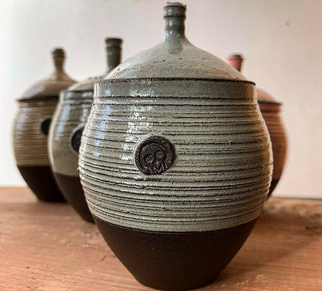 Small textured lidded pots