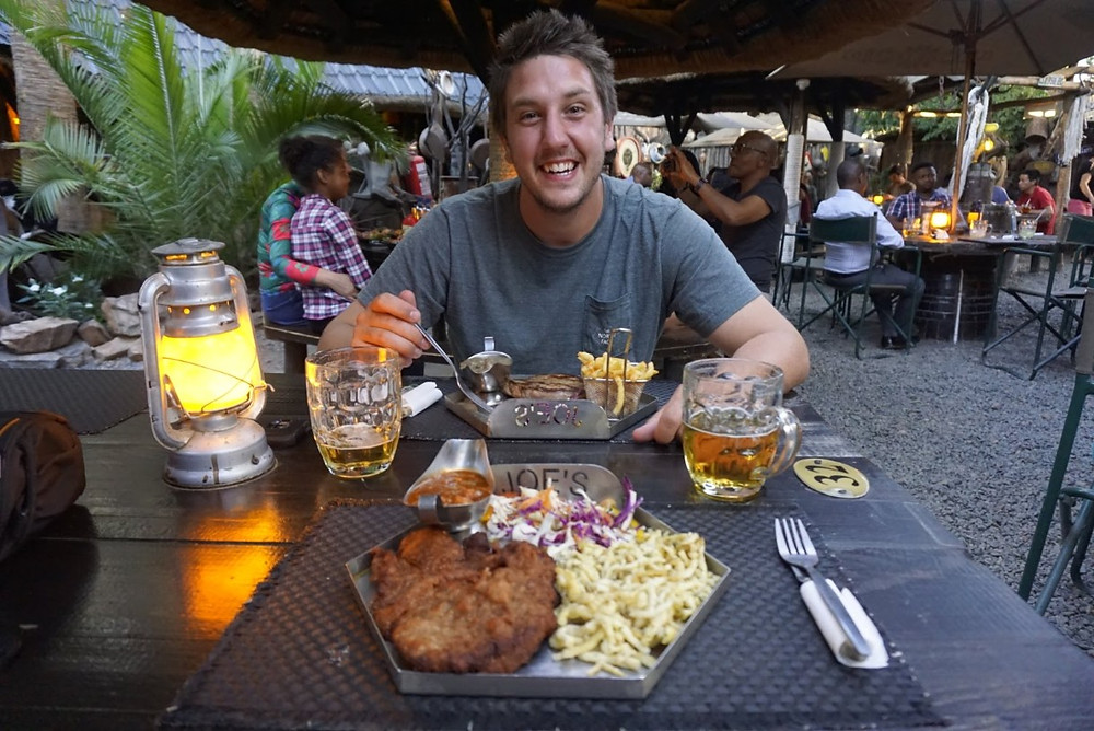 Lucas with Kudu steak and Oryz schnitzel at Joe's Beerhouse