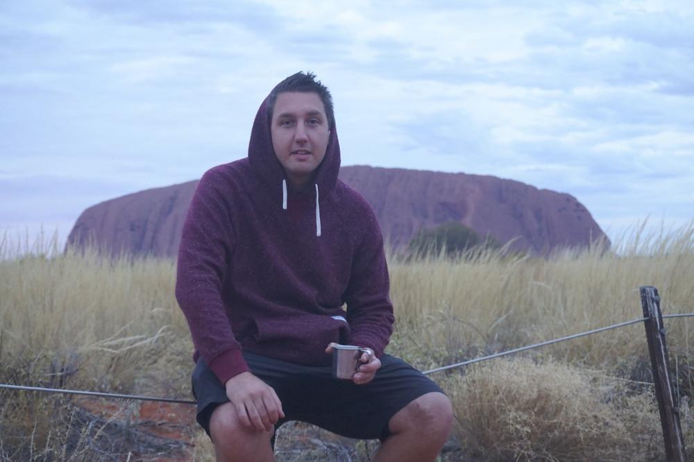 Lucas at sunrise in front of Uluru, Australia