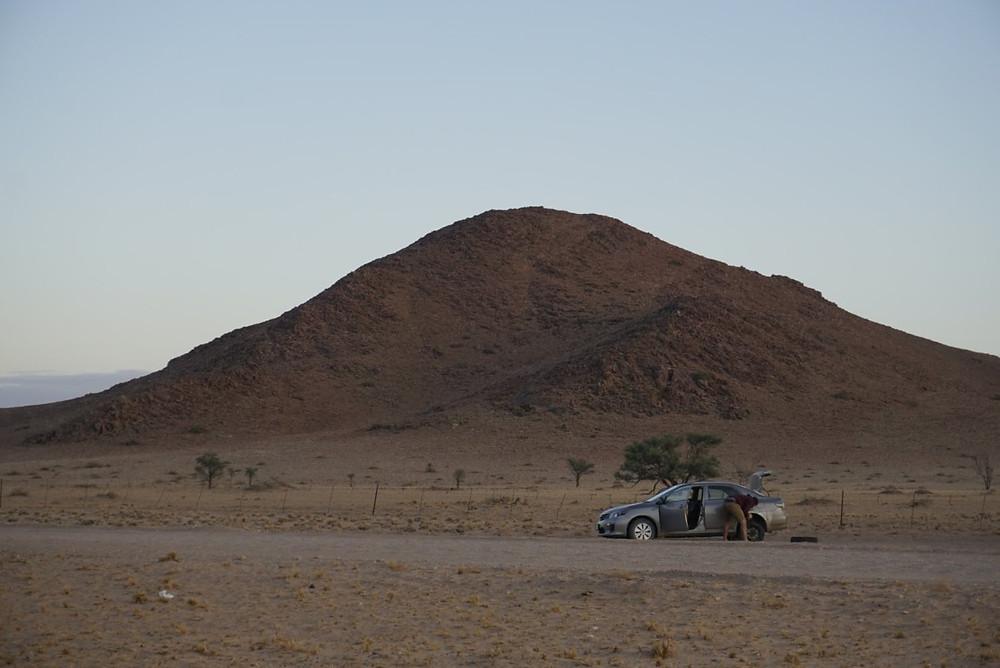 Lucas fixing tire in Namibian desert