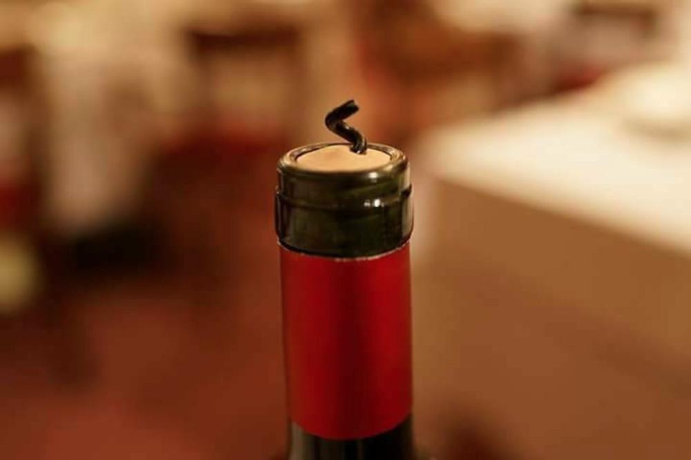 Broken cork screw in a bottle of Argentinian Malbec wine