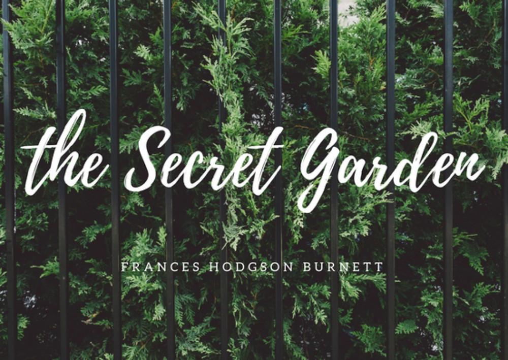 Hedge peeking through iron fence with The Secret Garden written on top