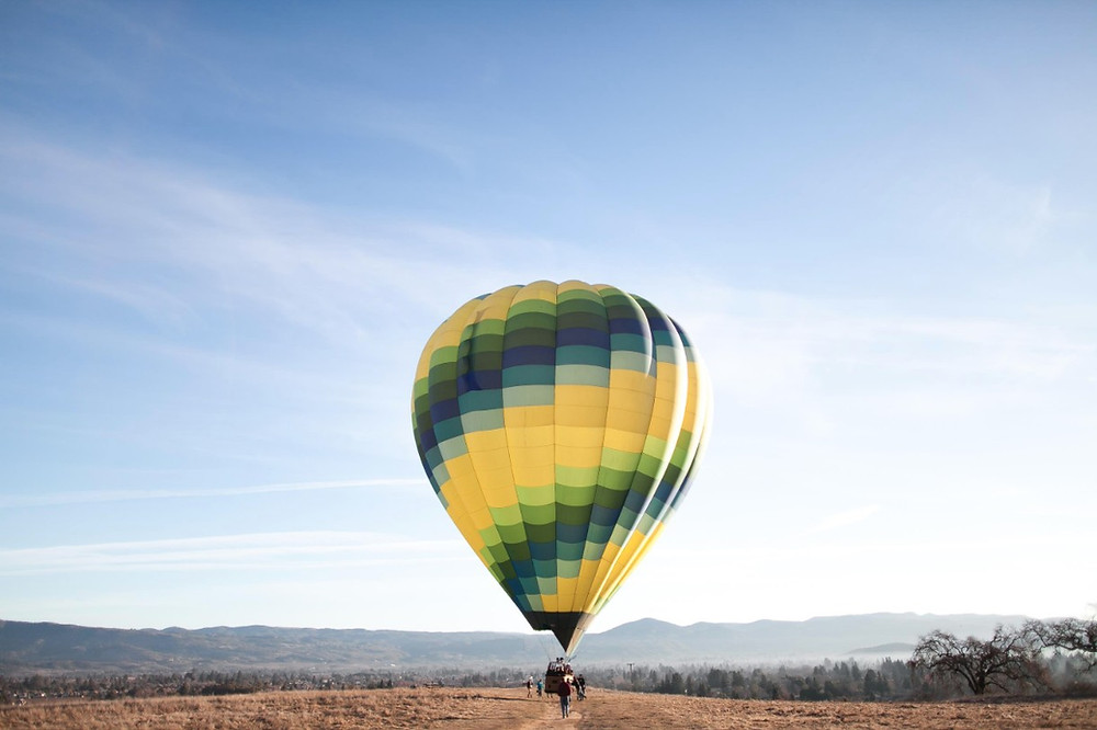 Hot air balloon ride on a sunny blue day
