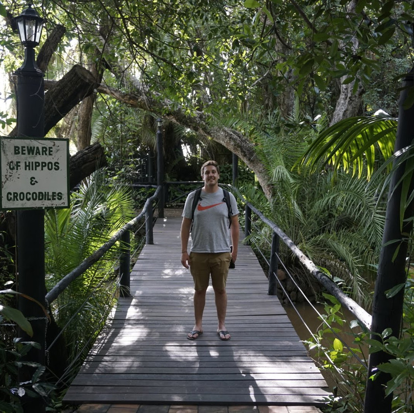 Lucas on Bridge with Warning Sign
