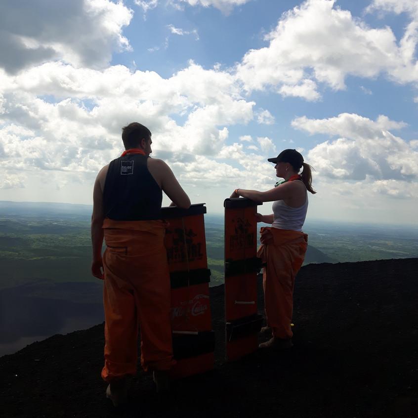 Missy and Lucas on top of Cerro Negro volcano boarding
