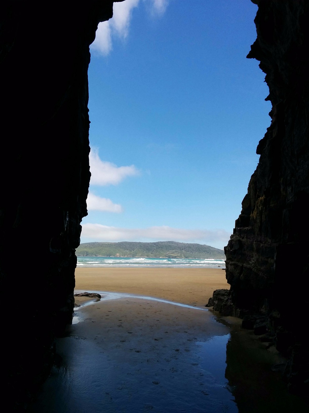 Facing out toward the ocean from inside Cathedral Caves
