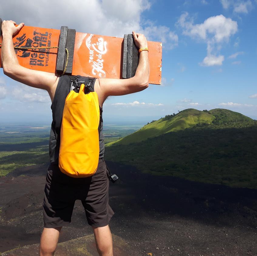 Lucas on top of Cerro Negro volcano boarding