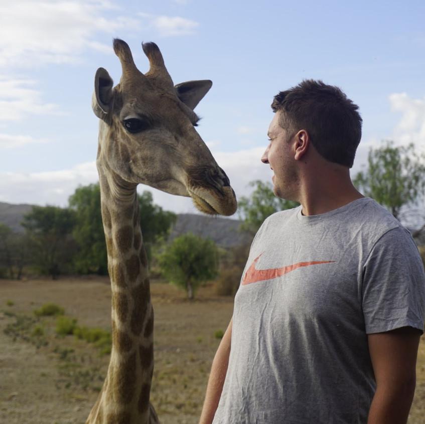 Lucas and Giraffes at Oudtshoorn