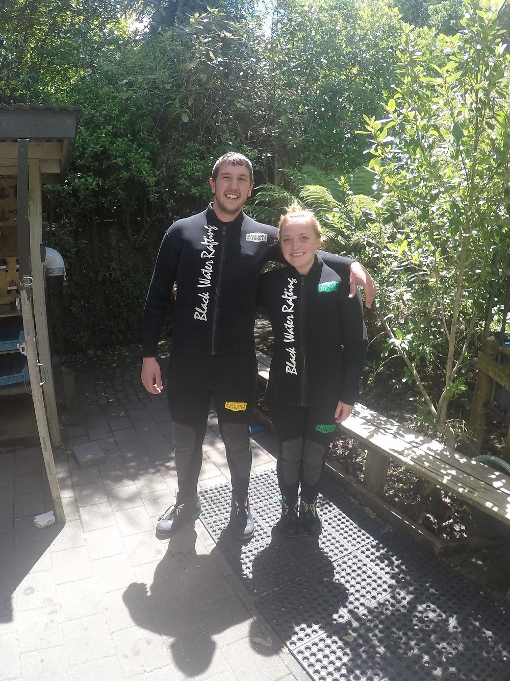 Missy and Lucas in wetsuits ready to blackwater raft