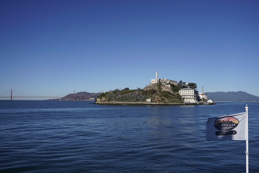 Alcatraz Island with Golden Gate Bridge behind