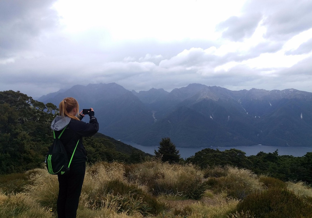 Missy standing on Kepler track with mountain backdrop