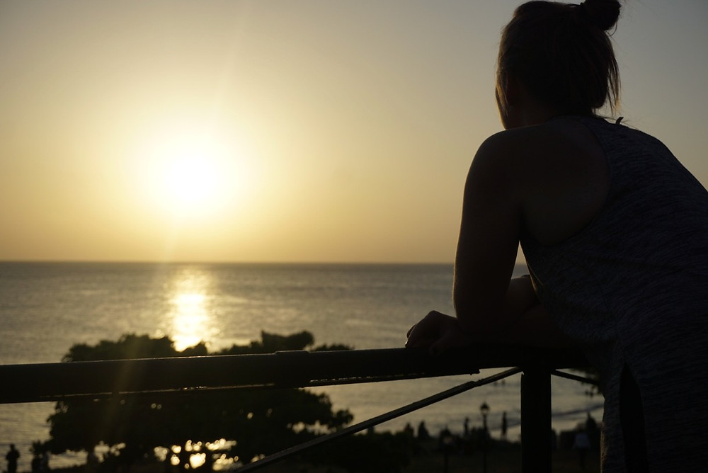 Missy silhouette watching sunset from Africa House Hotel