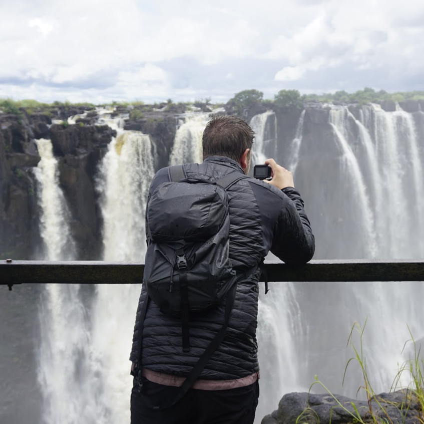 Lucas in front of Victoria Falls, Zambia